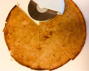 gluten-free vegan socca farinata cut into wedgesgluten-free vegan socca farinata cut into wedges