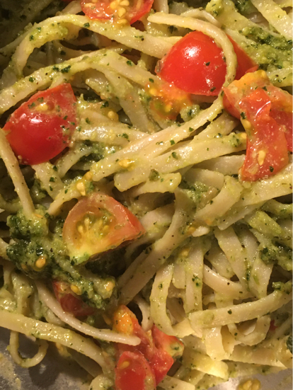 perfect vegan pesto in gluten-free fettuccine with cherry tomatoes