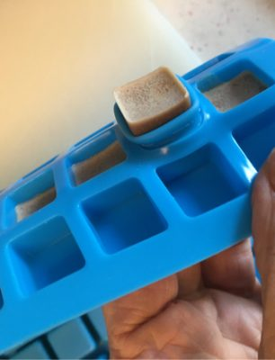 protein candy square popping out of mold