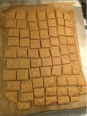 separated cassava crackers on baking sheet